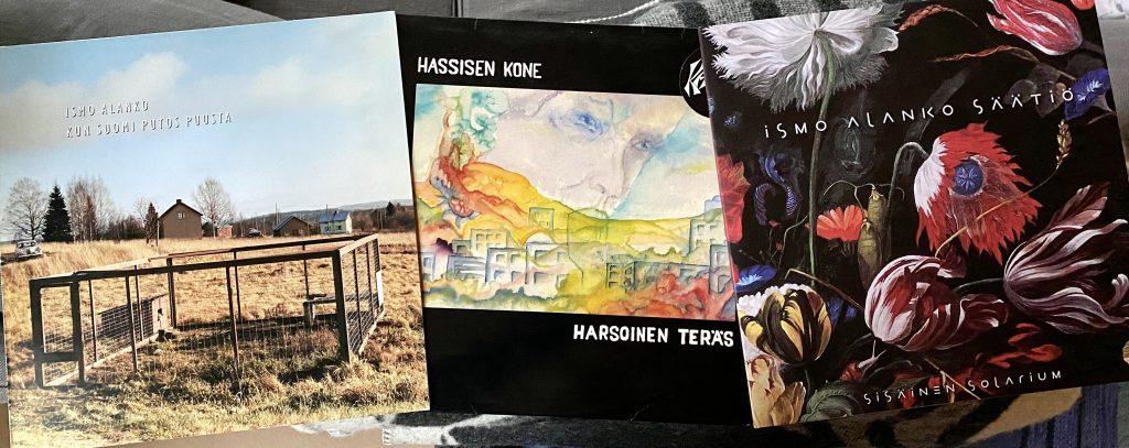 Ismo Alanko: Kun Suomi putos puusta (1990), Hassisen Kone: Harsoinen teräs (1982) ja Ismo Alanko Säätiö: Sisäinen solarium (2000).